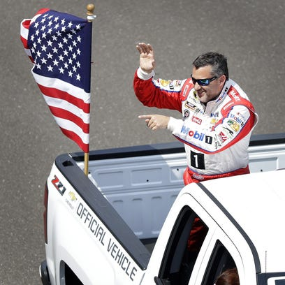 Sprint Cup Series driver Tony Stewart (14) on the parade
