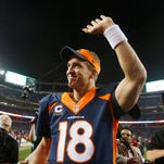 Oct 19, 2014; Denver, CO, USA; Denver Broncos quarterback Peyton Manning (18) waves to the crowd as he runs off the field after the game against the San Francisco 49ers at Sports Authority Field at Mile High. Mandatory Credit: Chris Humphreys-USA TODAY Sports