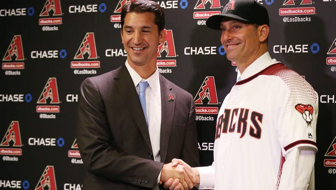 Arizona Diamondbacks Executive Vice President and General Manager Mike Hazen (left) introduces the team's new manager Torey Lovullo during a press conference at Chase Field on Nov. 7, 2016 in Phoenix.