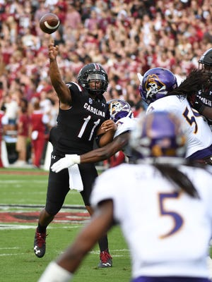 University of South Carolina quarterback Brandon McIlwain (11) avoids a sack by East Carolina University during Saturday's game at Williams-Brice Stadium.