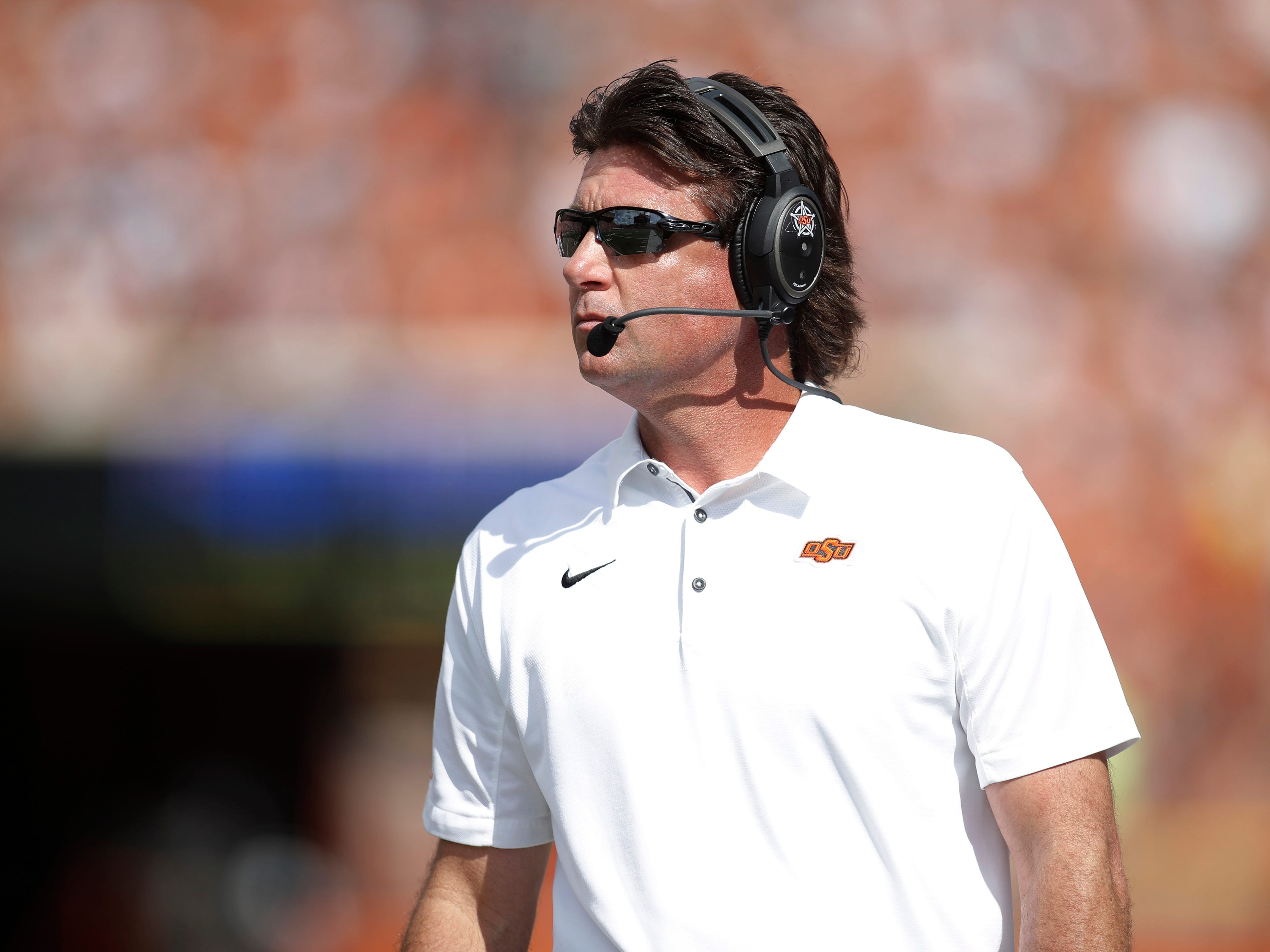 Oklahoma State Cowboys head coach Mike Gundy on the sidelines against the Texas Longhorns at Darrell K Royal-Texas Memorial Stadium.