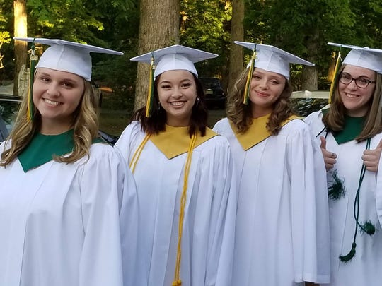(From left) Kaitlyn Alexis Levari of Buena, Juliehan Nguyen of Vineland, Jordan Taylor Ruberti of Vineland, and Alyssa Nicole Allen of Rosenhayn, members of the Class of 2018, prepare to attend the Baccalaureate Mass during Our Lady of Mercy Academy's graduation.