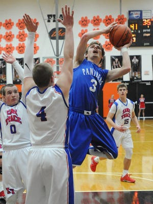 Southeastern's Justin Dye takes a shot over Zane Trace's Carter Groff-Tolbert Monday at Waverly's downtown gym.