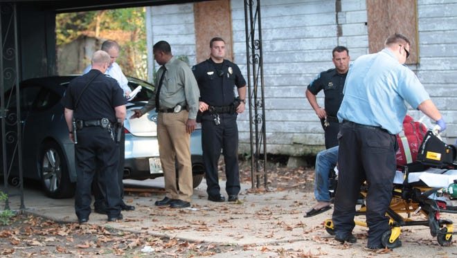 Monroe police investigate a  shooting in the 900 block of Atkinson Street in Monroe on Wednesday.