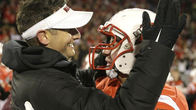 Kimberly head coach Steve Jones celebrates with Mason Bartol after the Papermakers' 29-14 victory over Franklin in the Division 1 state championship at Camp Randall Stadium. Jones has been named as the Wisconsin Football Coaches Association/Green Bay Packers' Coach of the Year.