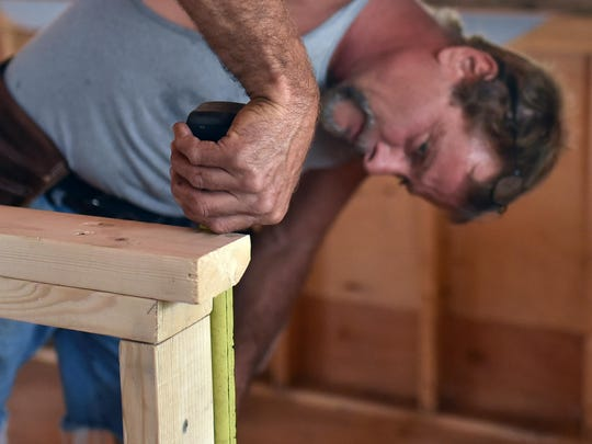 Paul Santoro of E.D. Builders in Vineland works on the interior of the Double Eagle Saloon, which is being restored after a devastating fire last year.   on Double Eagle Saloon at 1477 Panther Rd, Vineland.