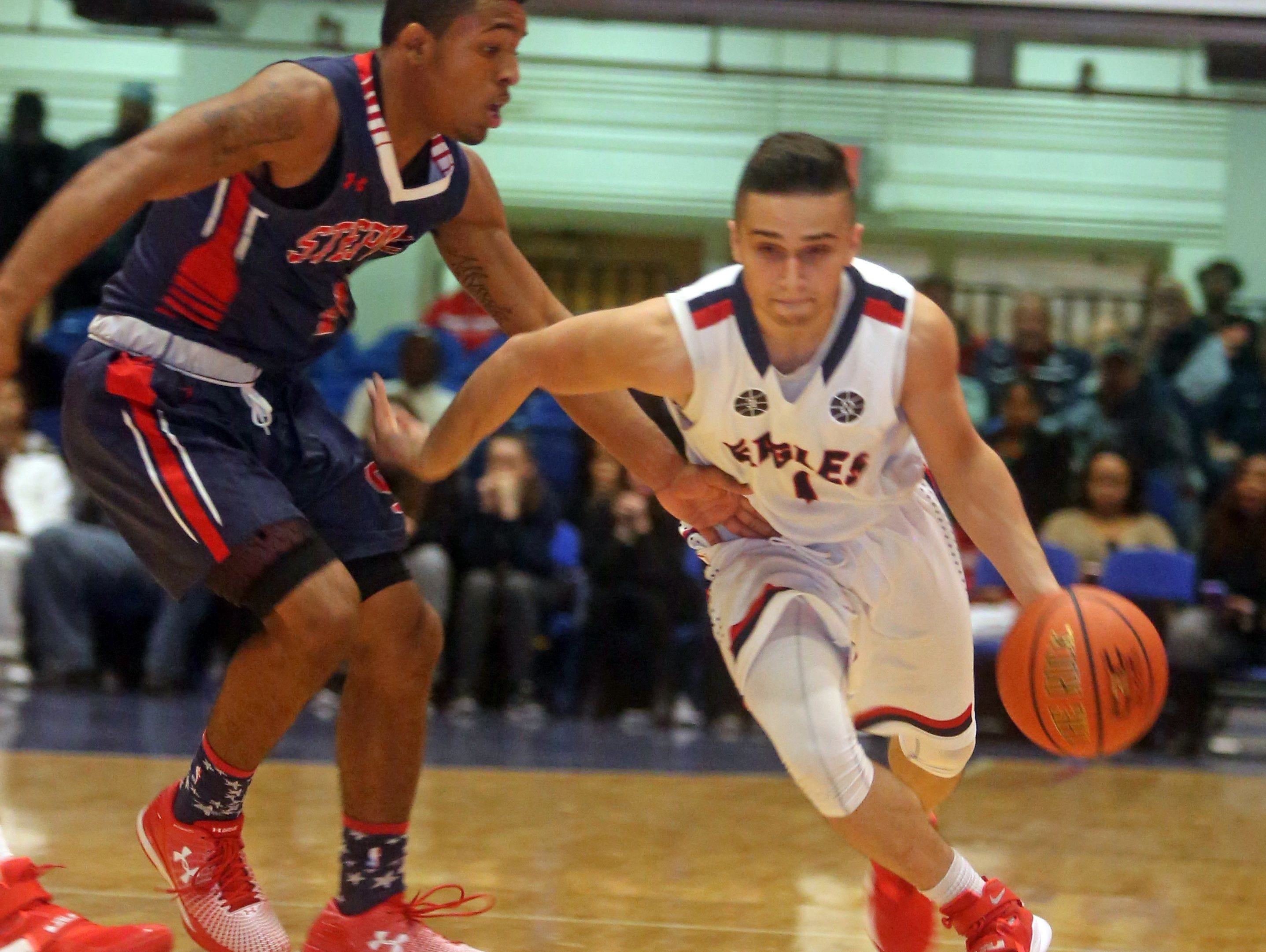 Eastchester's Benny DiMirco drives during Eastchester's 57-54 loss to Stepinac at the Slam Dunk Tournament at the Westchester County Center in White Plains Dec. 26, 2015.