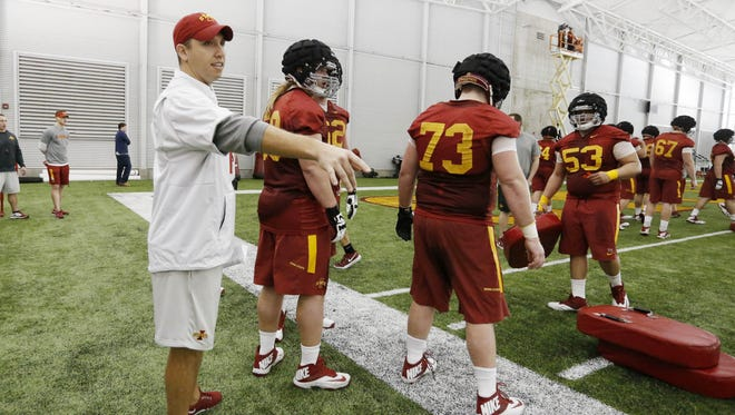 Head football coach Matt Campbell runs players through drills Tuesday, March 8, 2016, during spring practice in the Bergstrom Football Complex at Iowa State University in Ames. The Cyclones will hold a closed scrimmage on Saturday.