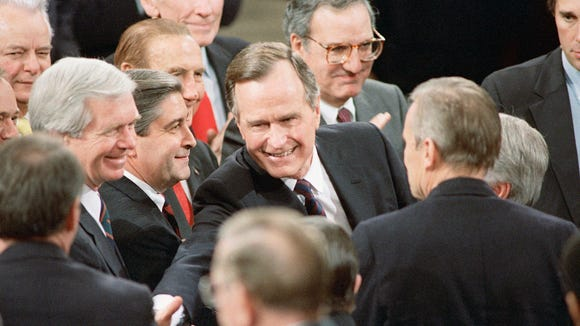 President Bush is surrounded by members of Congress