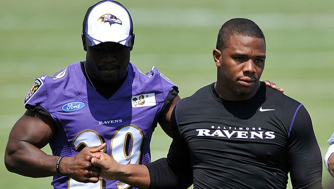 FILE - In this July 31, 2014, file photo, Baltimore Ravens running back Ray Rice, right, walks off the field with Justin Forsett before addressing the media at a news conference after NFL football training camp practice in Owings Mills, Md.