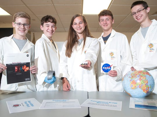Members of the Boy Scouts of America's STEM Scouts program, from left, Jacen Januseski, Mason Conger, Emily Paulin, Jason Bupp, and Caeden Conklin  are shown in the Westampton-based high school lab. They submitted a winning experiment proposal to the Cubes in Space global research competition. In September, their experiment will fly aboard a NASA zero-pressure scientific balloon.