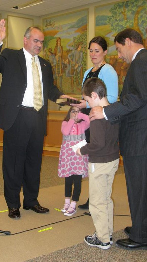 Andy Moore (Town Council) was sworn in by the Honorable E. Daniel Quatro who was assisted by Andy's son, Thomas.