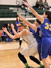 Cloudcroft's Diana Cook, left, tries to grab a loose ball while being heavily guarded.