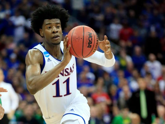 FILE - In this March 25, 2017, file photo, Kansas guard Josh Jackson pass the ball during the second half of a regional final against Oregon in the NCAA college basketball tournament in Kansas City, Mo.  The former Kansas basketball player must undergo anger management classes and apologize as part of a diversion agreement arising from a confrontation with a women's basketball player. (AP Photo/Orlin Wagner, File)
