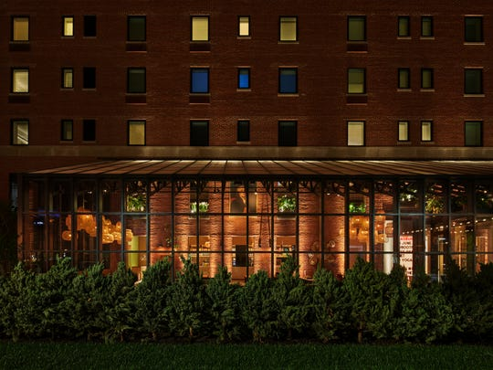 The sunroom of The Asbury Hotel glows warmly on a winter night.