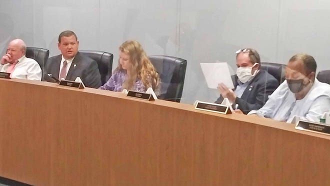 Mayor Pro-Tem Brett Williams (fourth from left) leads his first meeting as interim mayor on Nov. 9.