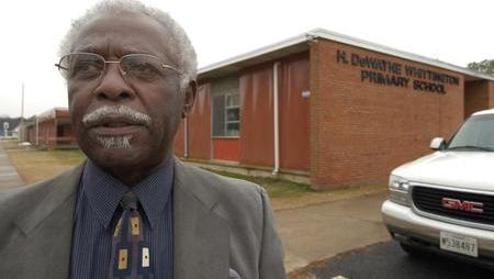 This 2004 Daily Times file photo shows former Somerset County Superintendent of Schools, H. DeWayne Whittington, outside the former primary school building in Crisfield named in his honor. Plans are to tear down the structure that was severely damaged in 2012 by flood water during Hurricane Sandy.