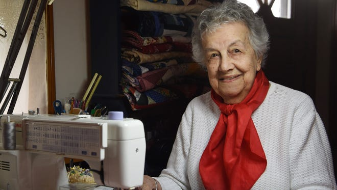 Marie Clark, pictured in her Dover Plains home. She has been quilting, particularly by hand, for decades.