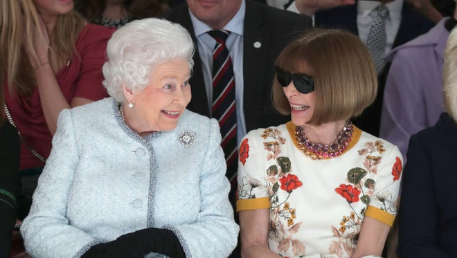 Queen Elizabeth and Anna Wintour appear to be enjoying each other's company during London Fashion Week Tuesday.
