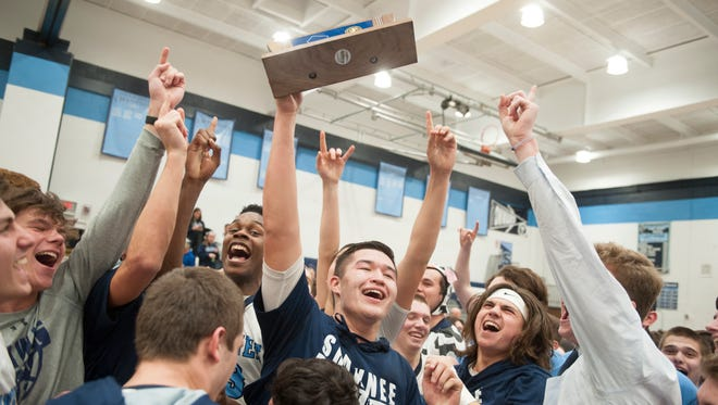 Members of the Shawnee boys basketball team celebrate their 61-48 win over Atlantic City in the South Jersey Group 4 boys basketball final played at Shawnee High School in Medford on Monday.