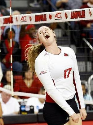 Louisville's Tess Clark celebrates making a kill during a match Dec. 4. Clark said the Cardinals are running intense preseason practices.