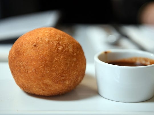 A papa rellena is a Cuban take on mashed potatoes, which are stuffed with seasoned ground beef and rolled into a ball, then breaded and fried.