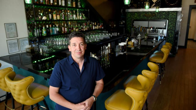 Allan Soto stands inside his latest venture, Pineapple Ink Tavern on Broad Street. He also runs a network of assisted-living homes and clinics for adults with intellectual and developmental disabilities.