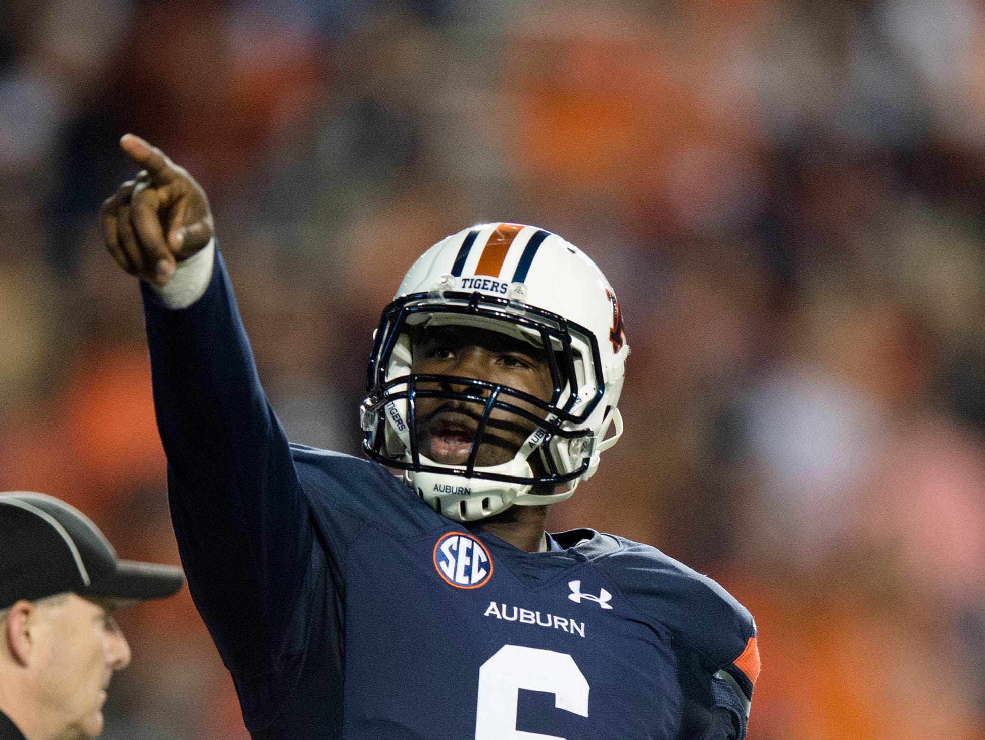 Auburn Tigers quarterback Jeremy Johnson (6) points towards the ROTC section after scoring a touchdown during the NCAA football game between Auburn and Idaho on Saturday, Nov. 21, 2015, at Jordan-Hare Stadium in Auburn, Ala. Albert Cesare / Advertiser
