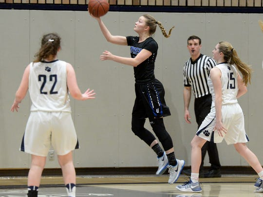 U-Prep's Sophia Altemus goes up for a layup in front of Marin Catholic's Tess Polizzotti and Miranda Jacobson during their NorCal D-IV playoff game in Kentfield on Wednesday. U-Prep lost 40-36.