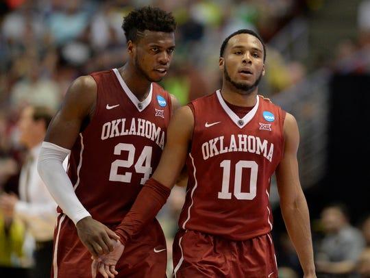 Oklahoma Sooners guard Buddy Hield and Jordan Woodard.