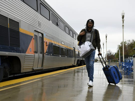 Passengers board an Amtrak train headed to Jack London Square in Oakland out of the Hanford station Wednesday morning.