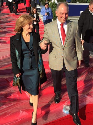 Gov.-elect John Bel Edwards and future First Lady Donna Edwards made a test run on the Capitol's red carpet steps Sunday in preparation for Monday's inaugur- ation.