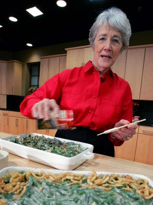 In this Nov. 15, 2005 file photo, a Green Bean Cassorole sits in the foreground as Dorcas Reilly prepares another at the Campbell Soup Co. corporate kitchen in Camden, N.J. Reilly died on Oct. 15, 2018.