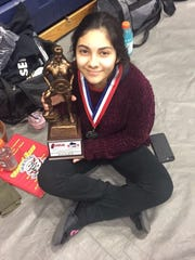 Yadira Ortiz of Sturgeon Bay with the trophy she earned for placing second in the girls 44-kilo (97-pound) class at the Wisconsin high school powerlifting championships.