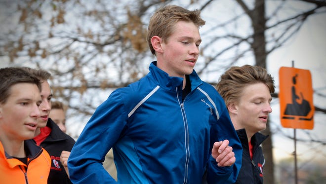 Rocori High School standout cross country runner Noah Lahr, center, in blue, run through the Cold Spring neighborhoods Tuesday, Oct. 27 with Will Glisky, right, a captain, and the rest of the team.