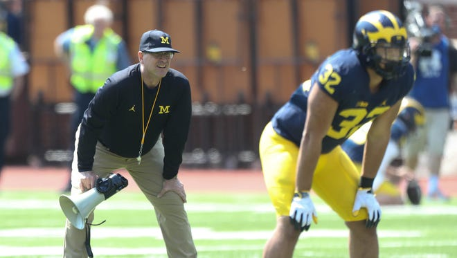 Michigan head coach Jim Harbaugh watches the spring game Saturday, April 15, 2017 at Michigan Stadium in Ann Arbor.