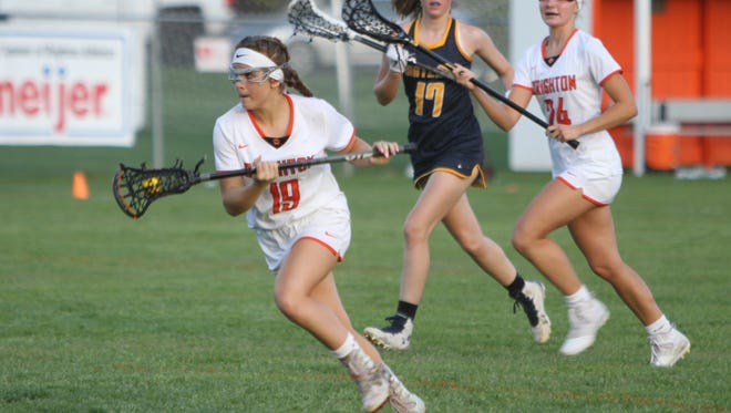 Brighton's Cat Kopchia drives to the net to score one of her five goals in a 16-15 lacrosse victory over Hartland on Monday, May 14, 2018.