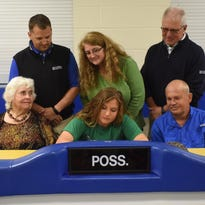 Mountain Home Lady Bomber golfer Leah Rowe signed a National Letter of Intent to play at the University of Arkansas-Monticello. Shown at the signing ceremony are: front row, from left, grandfather Bobby Walker, grandmother Joyce Walker, Rowe, father Danny Rowe; second row, MHHS golf coach Dell Leonard, mother Missy Rowe, and Big Creek professional Todd Dunnaway.