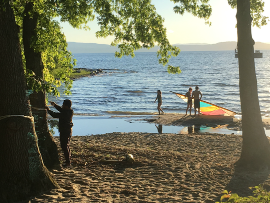 A quiet stretch of Blanchard Beach at Oakledge Park, Burlington, attracts waders, sailors and a hammock fan on Tuesday evening, June 19, 2018.