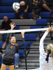 Gibsonburg's Lindsay Weickert sets the ball over the net Wednesday evening during their sectional game against Wynford.