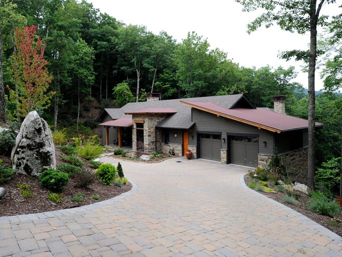Susan and Jim Jones home in Black Mountain sits on a mountainside with a view of the surrounding mountains.