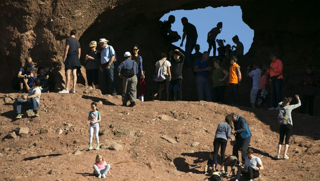 A busy day at the famous Hole-in-the-Rock feature at Papago Park in Phoenix on Dec. 28, 2017.