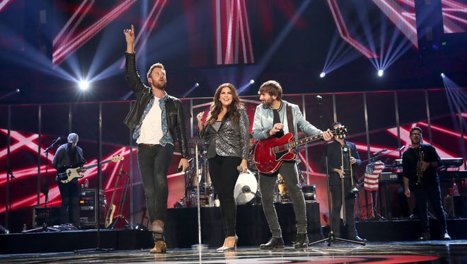 (L-R) Singers Charles Kelley, Hillary Scott, and Dave Haywood of Lady Antebellum perform during the 2017 iHeartCountry Festival.