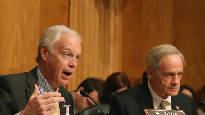 Senate Homeland Security and Governmental Affairs Committee Chairman Ron Johnson, R-Wis., foreground, and Sen. Tom Carper of Delaware, the committee's ranking Democrat, have raised concerns about oversight of labs working with dangerous pathogens.