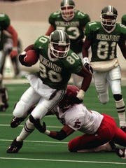 Michgan State's Derrick Mason #80 gets some good yardage on a return before being tackled by Indiana's Joe King #5.