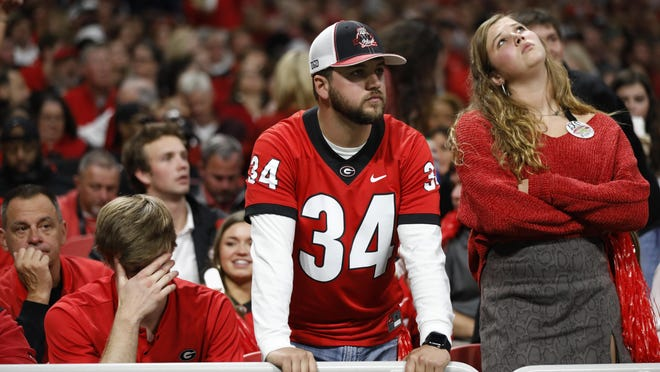Georgia fans reacts after during last season's SEC Championship loss to LSU in Mercedes-Benz Stadium.