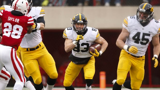 Receiver Riley McCarron (83) and fullback Drake Kulick (45) are the types of stories that need to emerge for the 2016 Hawkeyes to succeed.