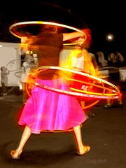 A woman shows her hula-hooping skills during a Guinness Book of World Records Hula-Hoop Contest at Hot August Nights.