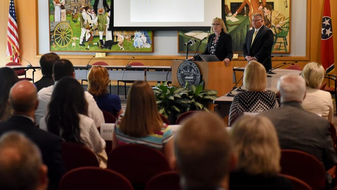 Dr. Amy Hawes, assistant medical examiner, explains a portion of the Regional Forensic Center's 2010-2015 Drug-related Death Report for Knox And Anderson Counties on Monday, Aug. 15, 2016, in the Small Assembly Room at the City County Building.  (MICHAEL PATRICK/NEWS SENTINEL)