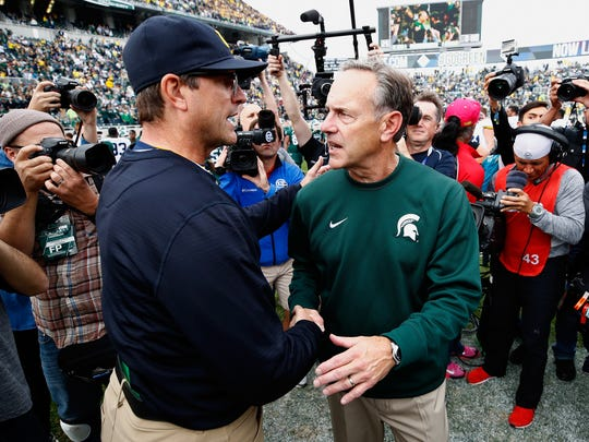 Michigan coach Jim Harbaugh, left, shakes hands with MSU coach Mark Dantonio after a 32-23 Wolverines win at Spartan Stadium on Oct. 29, 2016 in East Lansing.